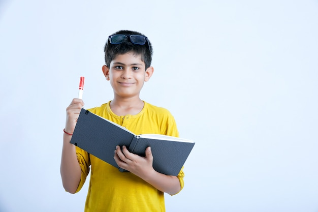Young indian cute boy with notebook Premium Photo