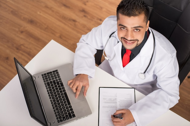 Young indian doctor in clinic. Premium Photo