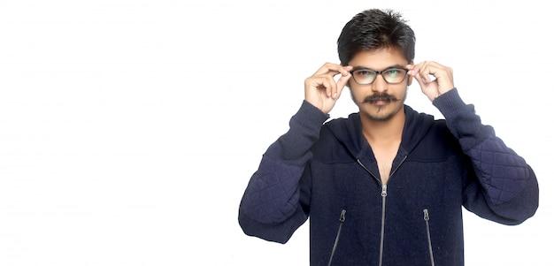 Young indian man holding eyeglases Premium Photo