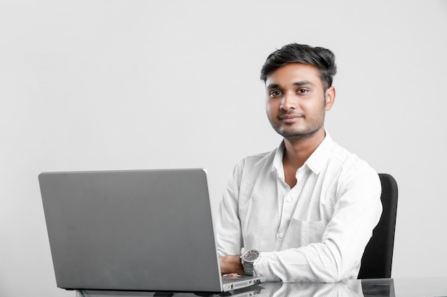 Young indian man working at office Premium Photo
