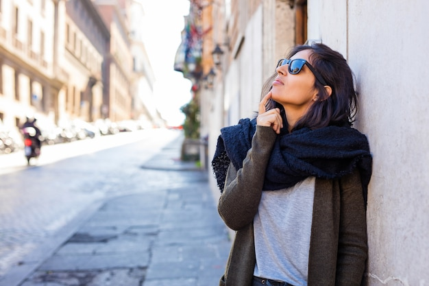 Young indian woman thinking at the street Premium Photo