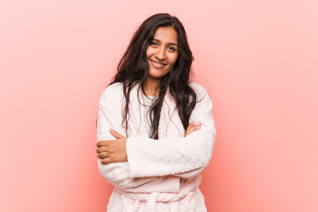 Young indian woman wearing pajama who feels confident, crossing arms with determination Premium Photo