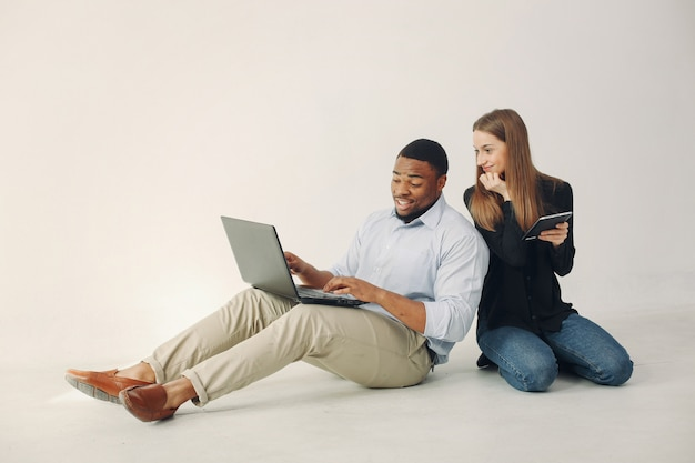 Young international couple working together and use the laptop Free Photo