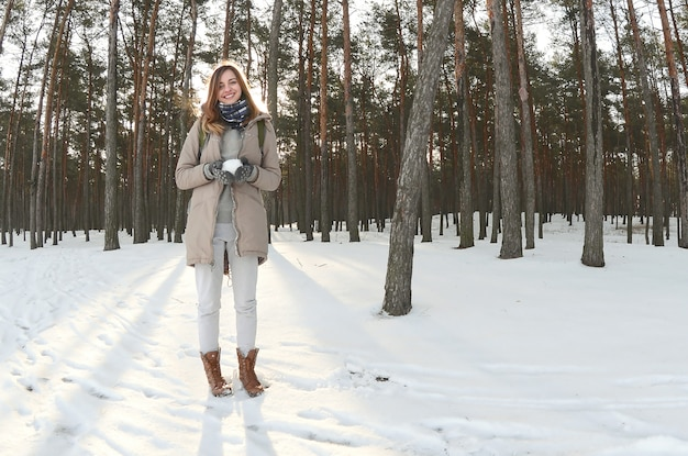 A young and joyful caucasian girl in a brown coat Premium Photo
