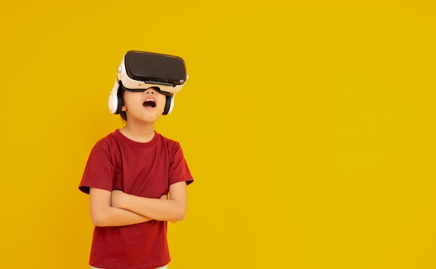 Young kid wearing vr glasses and surprised with real animation Premium Photo