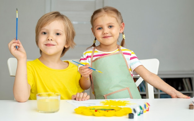 Young kids painting together Free Photo