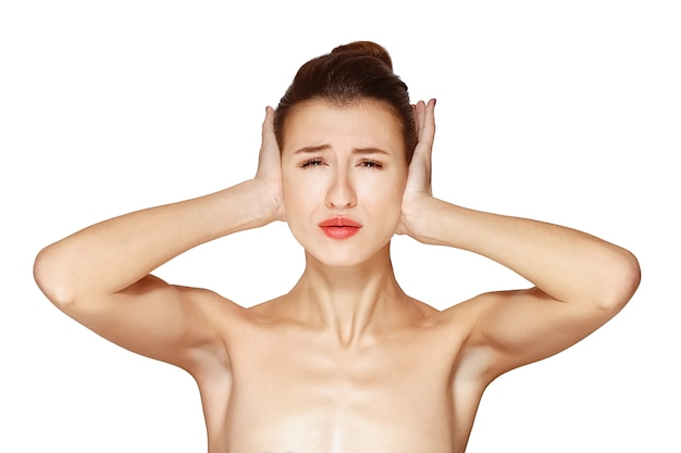Young lady closes her ears with hand Premium Photo