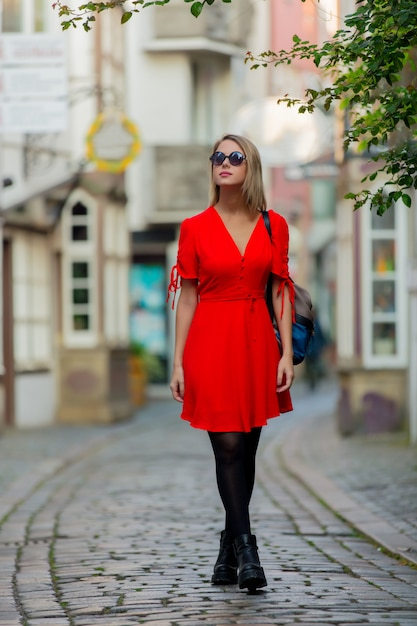 Young lady in dress on medieval street of bremen Premium Photo