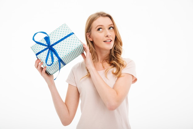Young lady holding surprise gift box. Free Photo