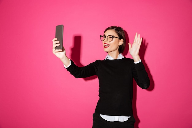 Young lady making selfie on smartphone isolated Free Photo