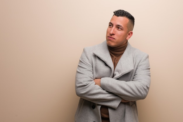 Young latin business man tired and bored Premium Photo