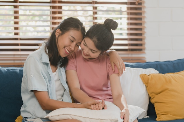 Young lesbian lgbtq asian women couple hug and kiss at home Free Photo