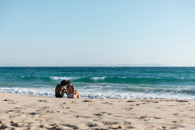Young lovely couple on tropical paradise beach Free Photo