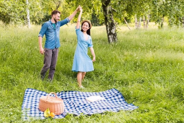 Young loving couple dancing happily in countryside Free Photo