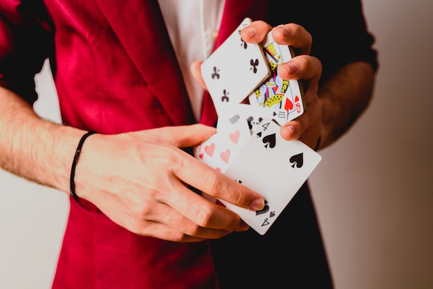 Young magician juggling a deck of playing cards. Premium Photo