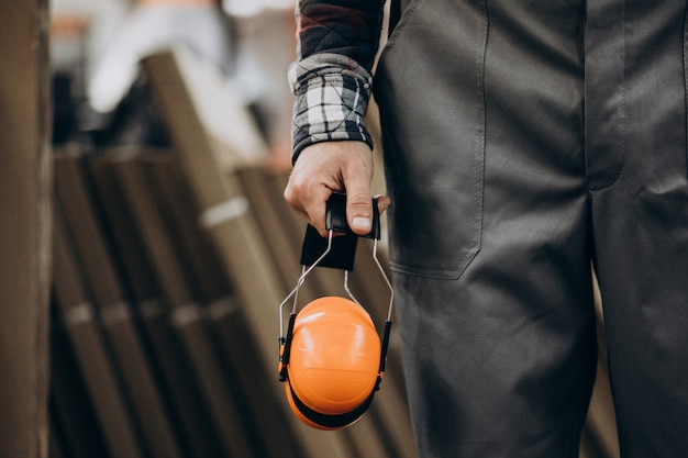 Young male handyman with safety earphones Free Photo