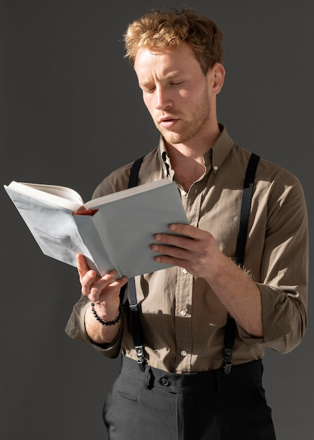Young male model reading a book Premium Photo
