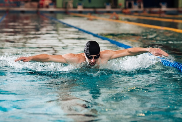 Young male at swimming pool training Free Photo