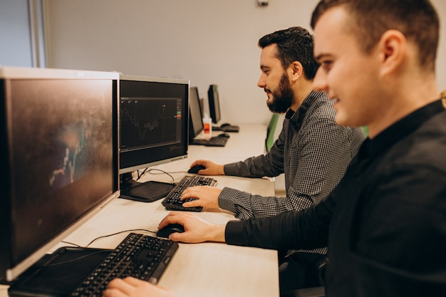 Young male web designers working on a computer Free Photo