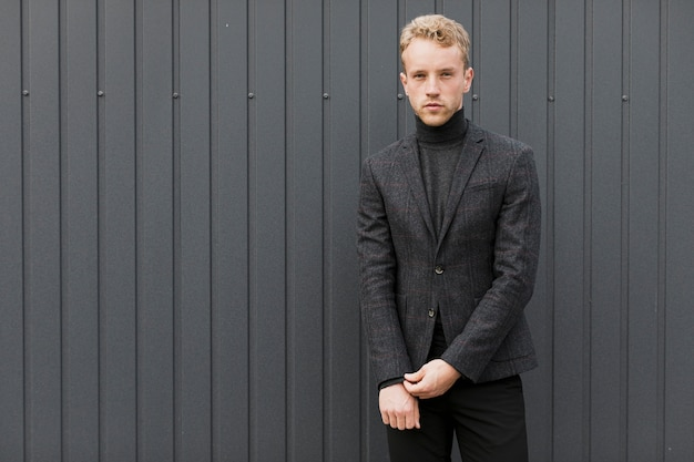 Young man arranging his jacket sleeve Free Photo