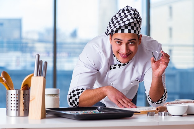 Young man cooking cookies in kitchen Premium Photo