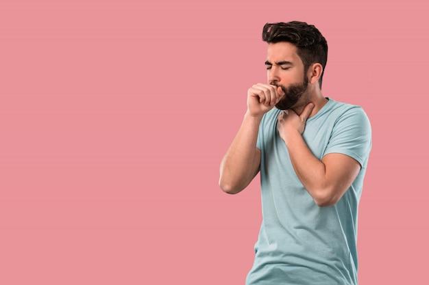 Молодой человек кашляет и болеет Premium Фотографии