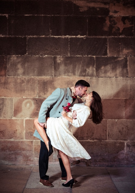 Young man dancing with pretty woman in street Free Photo