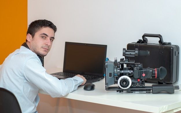 Young man designer using graphics tablet for video editing Premium Photo