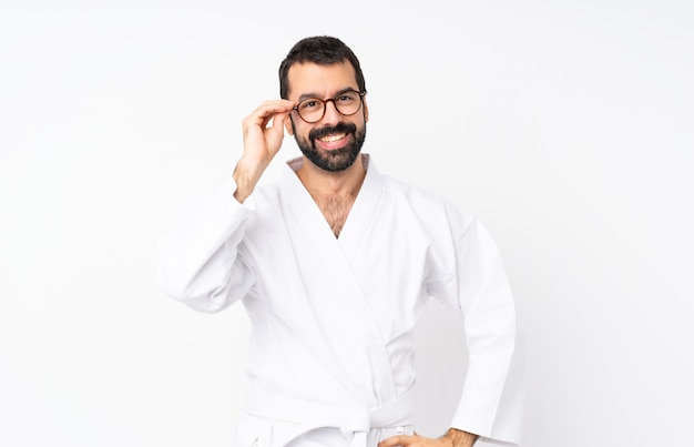 Young man doing karate with glasses and happy Premium Photo