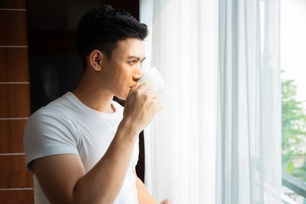 Young man drink coffee at home Free Photo
