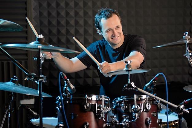 Young man behind drum-type installation. Premium Photo
