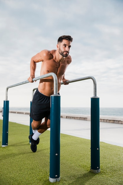 Young man exercising routine outdoor Free Photo