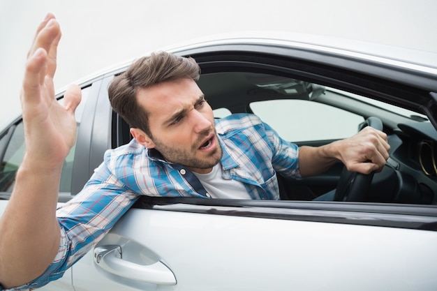 Young man experiencing road rage Premium Photo
