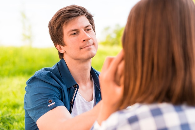 Young man gently stroking woman cheek Free Photo