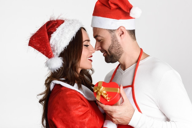 Gifts For Young Men: Young Man Giving A Christmas Gift To His Woman Photo