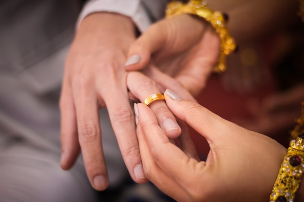 Young man giving an engagement ring to his girlfriend on valentine's day Premium Photo
