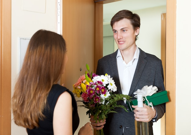 Young man giving gifts to woman Free Photo