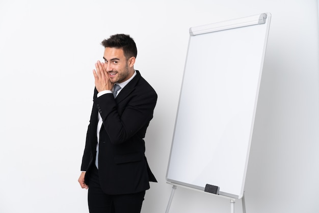Young man giving a presentation on white board and whispering something Premium Photo