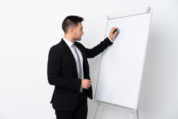Young man giving a presentation on white board Premium Photo