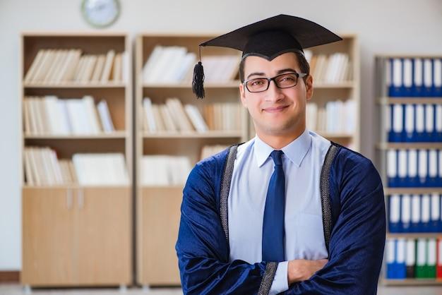 Young man graduating from university Premium Photo