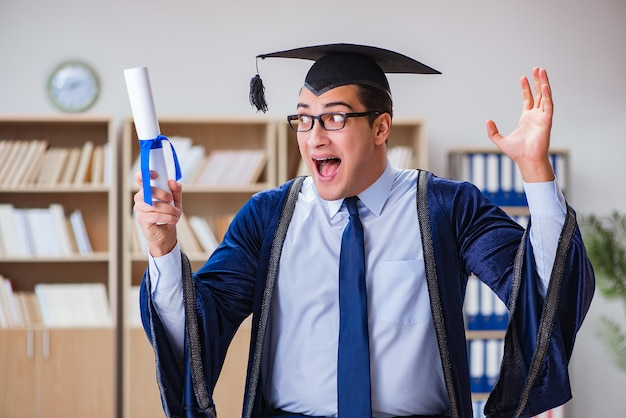 Young man graduating from university Premium Photo
