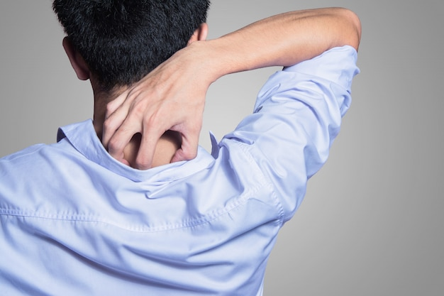 Young man hands scratching the itch on the back with shirt Premium Photo