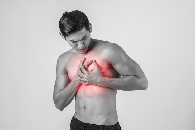 Young man has heart attack isolated on white background. Free Photo