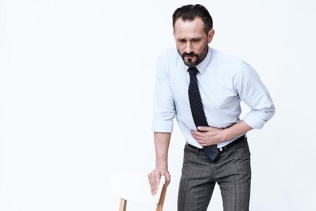 A young man has a stomach ache. Premium Photo