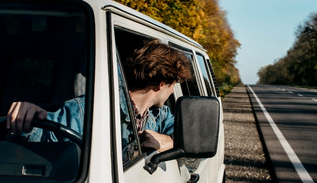 Young man having a roadtrip in his van Free Photo