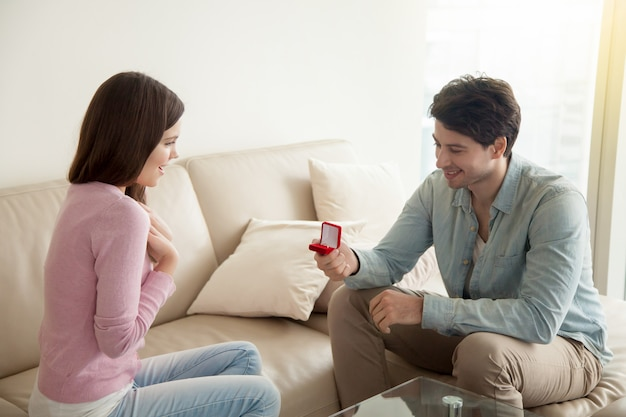 Young man holding engagement ring, making marriage proposal Free Photo