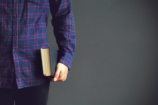 Young man holding the holy bible.book, reading, bible.copy space Premium Photo