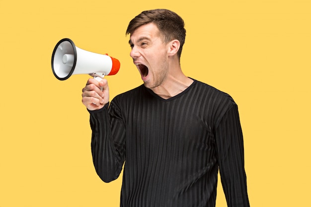 The young man holding a megaphone Free Photo