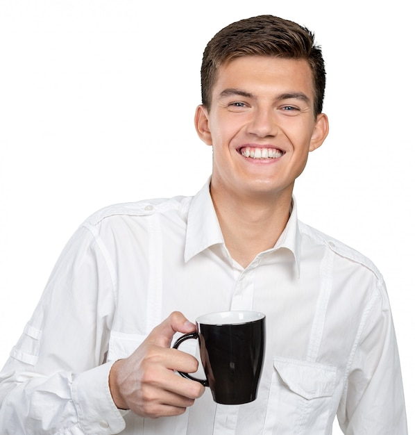 Young man holding warm cup of tea/coffee Premium Photo