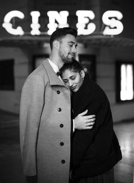 Young man hugging charming attractive woman on street Free Photo